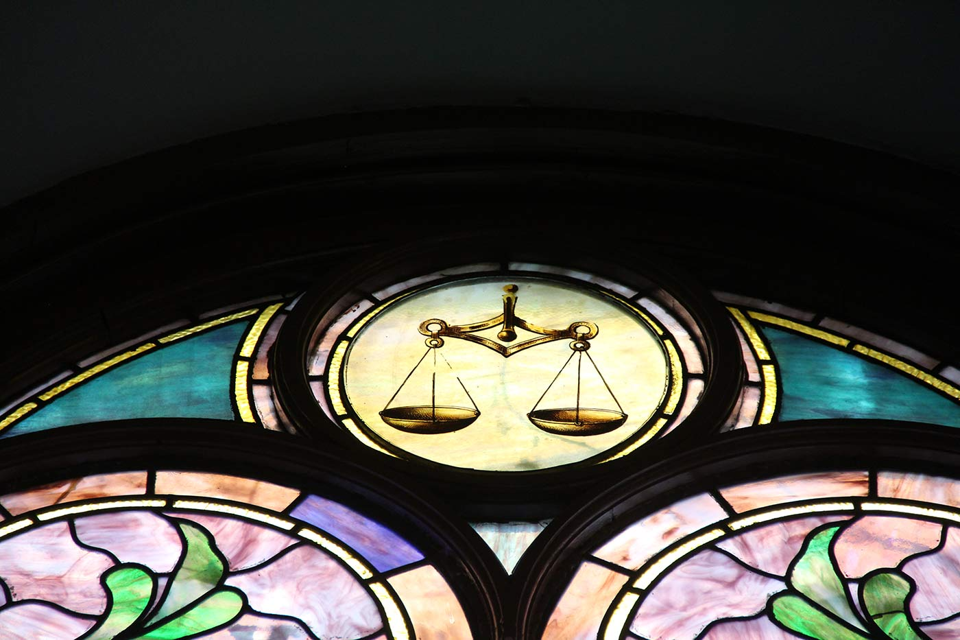 Stained glass detail: balance scale.
