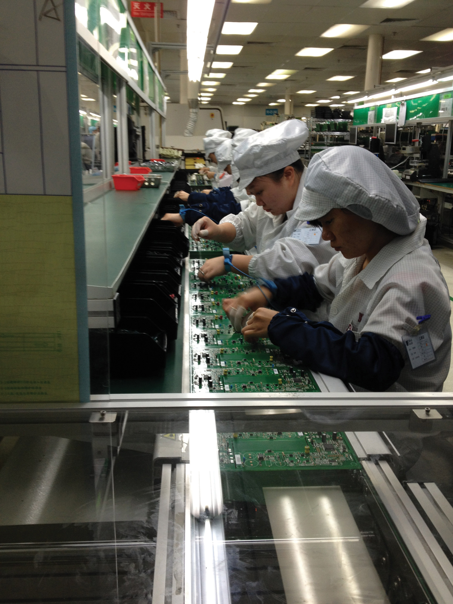 Factory workers in China assemble circuit boards. (Photo courtesy Dragon Innovation)