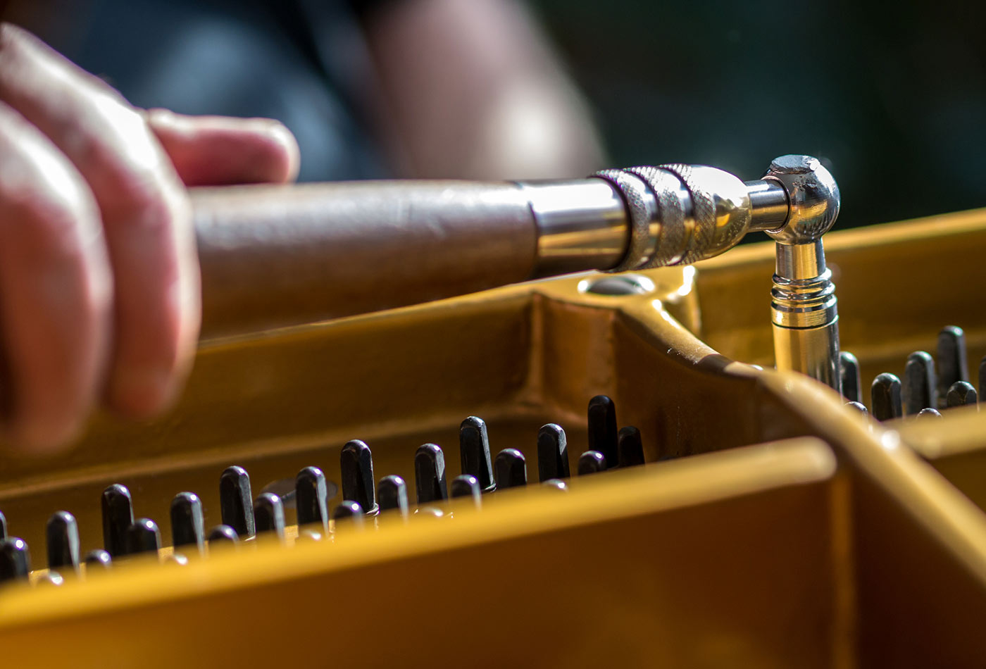 Tuning a grand piano.