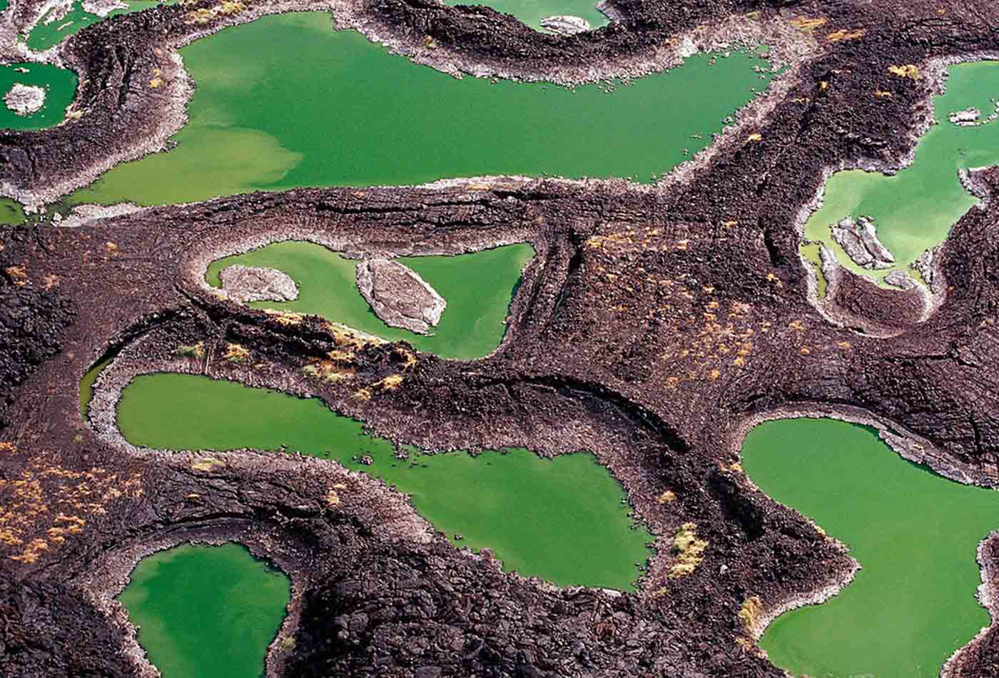 Series of lava rock pools situated just off the southern end of Lake Turkana, northern Kenya's Jade Sea