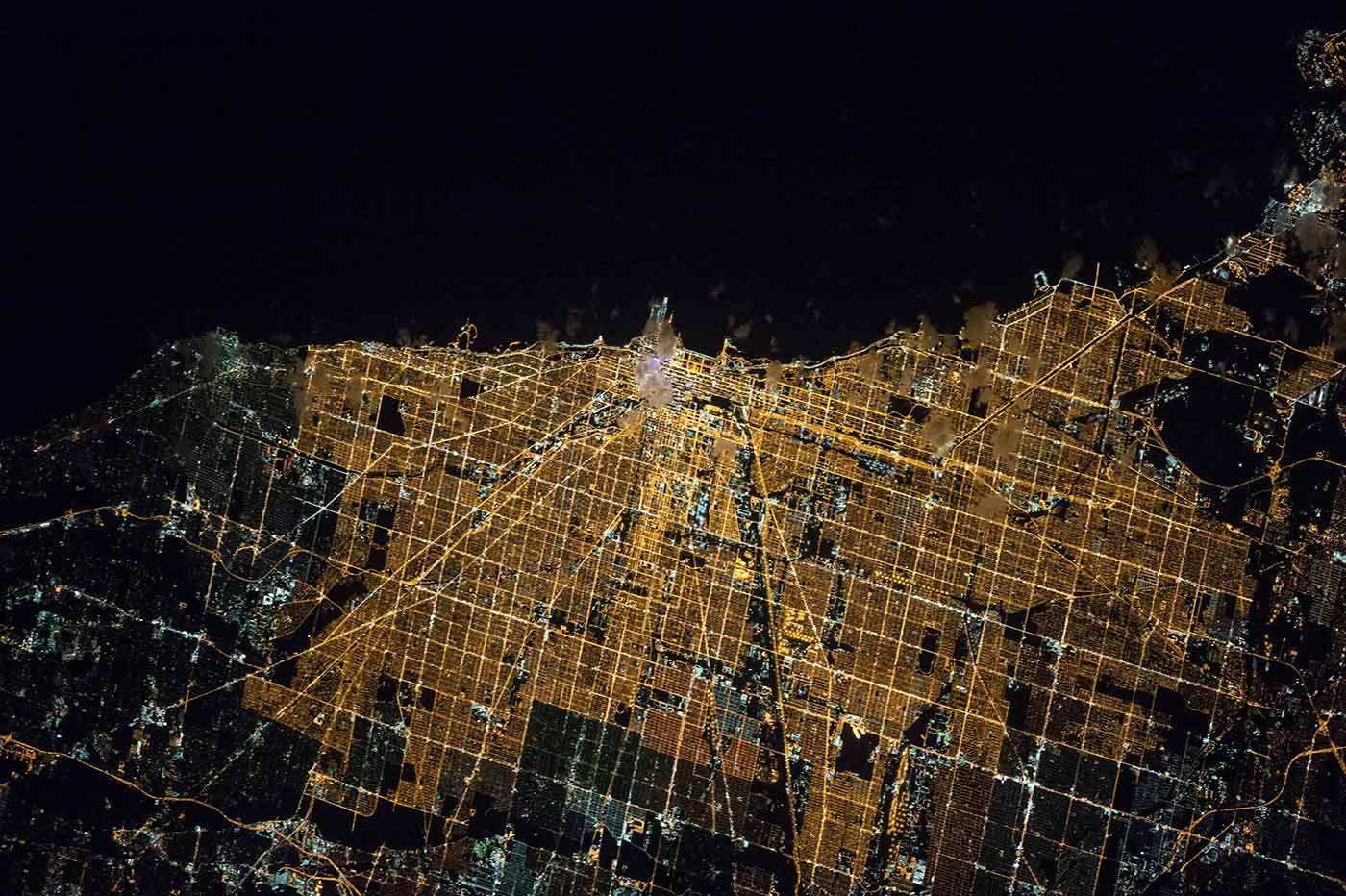 Expedition 47 Commander Tim Kopra of NASA captured this brightly lit night image of the city of Chicago on April 5, 2016, from the International Space Station.