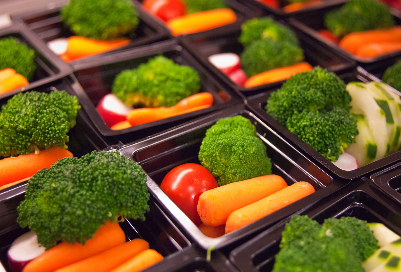 Fresh vegetable cups prepared for the National School Lunch Program