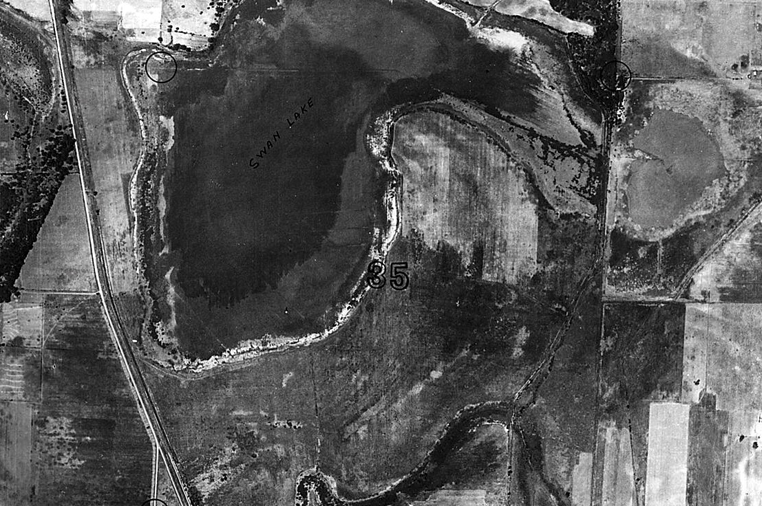 Aerial view showing lake and fields.