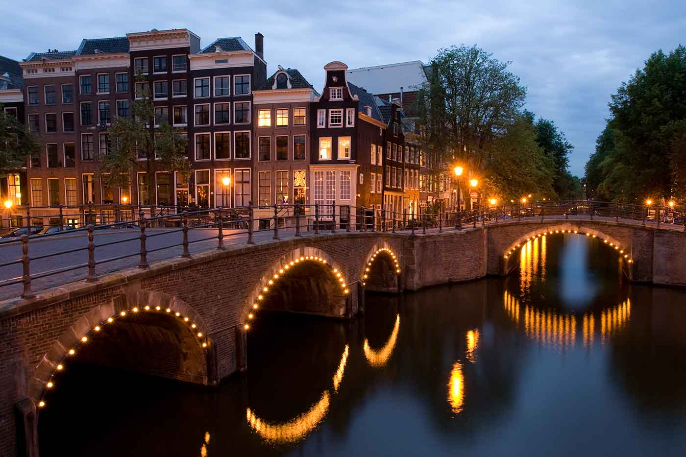 A view of the Reguliersgracht on the corner with the Keizersgracht, in Amsterdam, the Netherlands at dusk.
