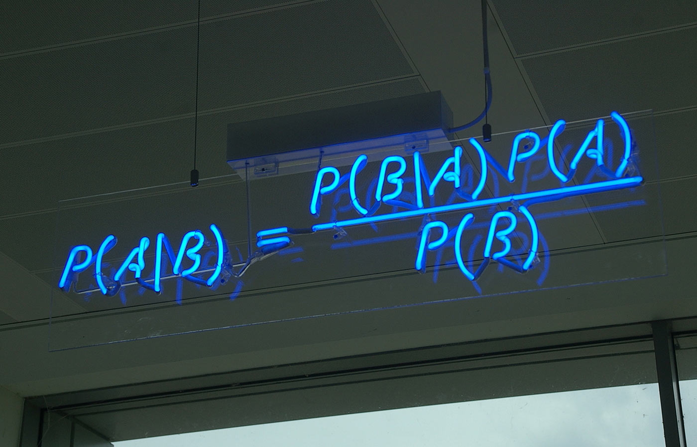 Bayes' theorem spelled out in blue neon at the offices of Autonomy in Cambridge.