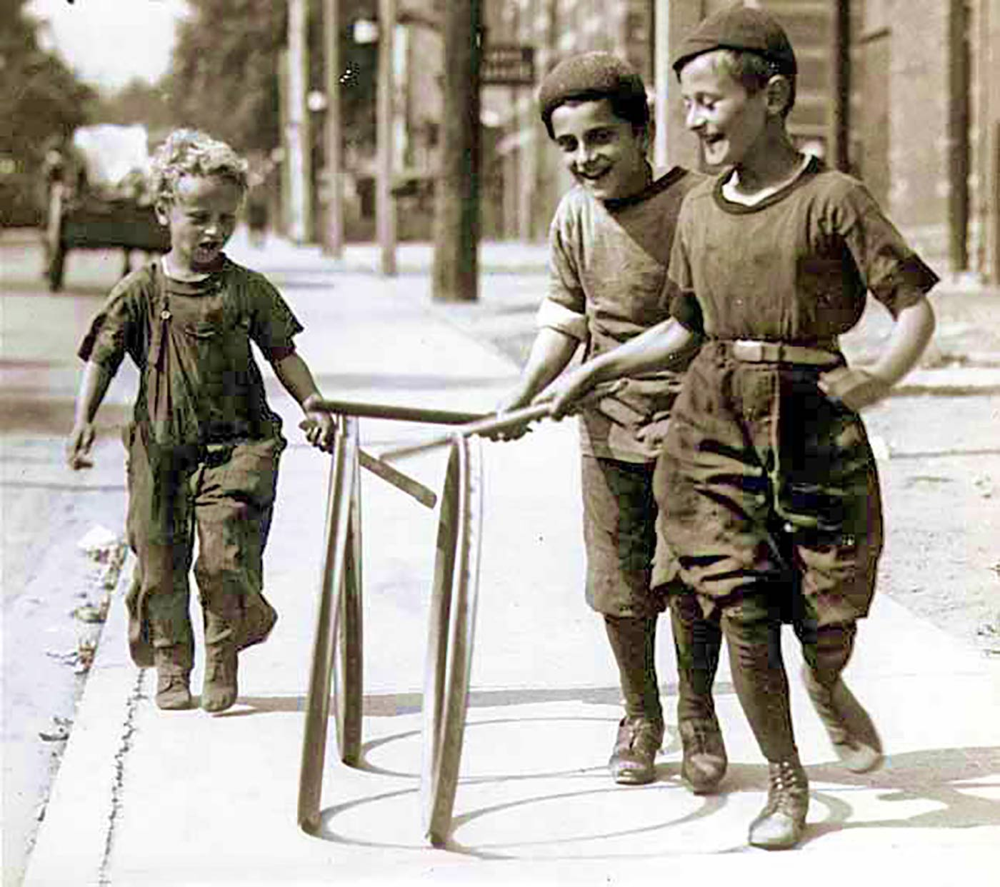 Boys playing with hoops on Chesnut Street, Toronto, Canada, 1922.