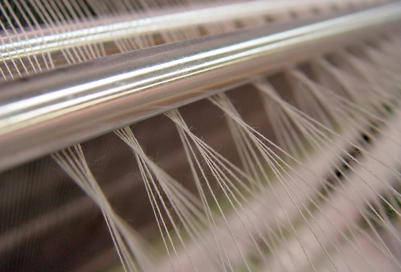 Woolen threads being woven in a loom