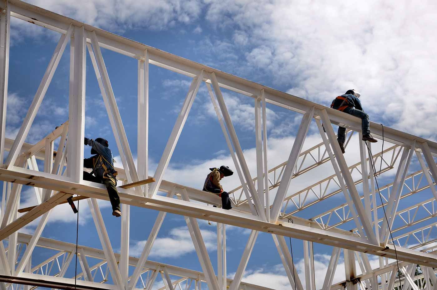 Workers on beams