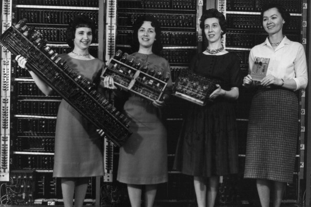 From Left to right: Patsy Simmers, Mrs. Gail Taylor, Mrs. Milly Beck and Mrs. Norma Stec, holding the ENIAC and newer versions of computer boards.