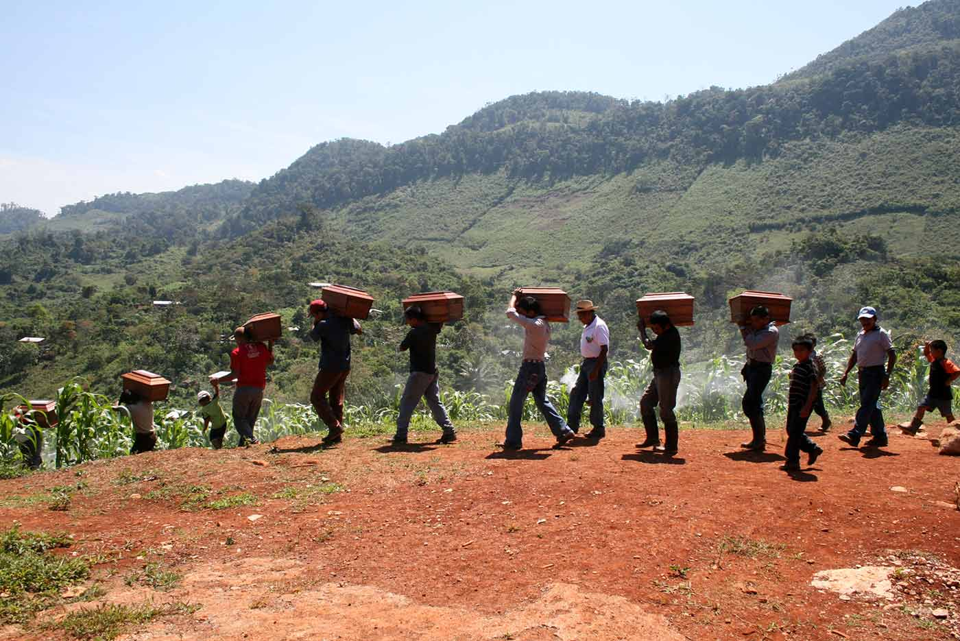 Queqchí people carrying their loved one's remains after an exhumation in Cambayal in Alta Verapaz department, Guatemala.