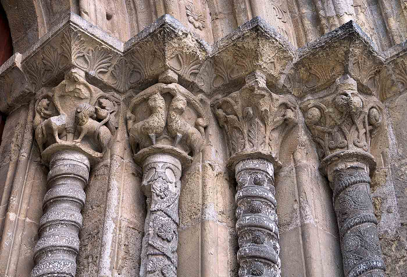 Vegetalist and animal intricate capital and column carvings in Santiago Church.