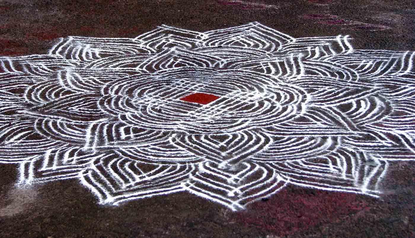 An intricate kolam chalk drawing the Kapaleeshwarar Temple in Mylapore, Chennai.