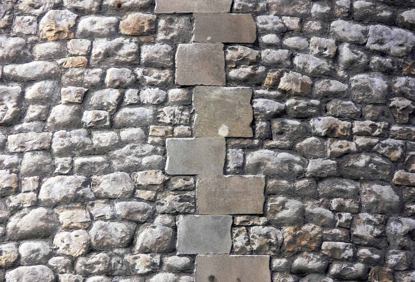 Interlocking Bricks In Stone Wall.