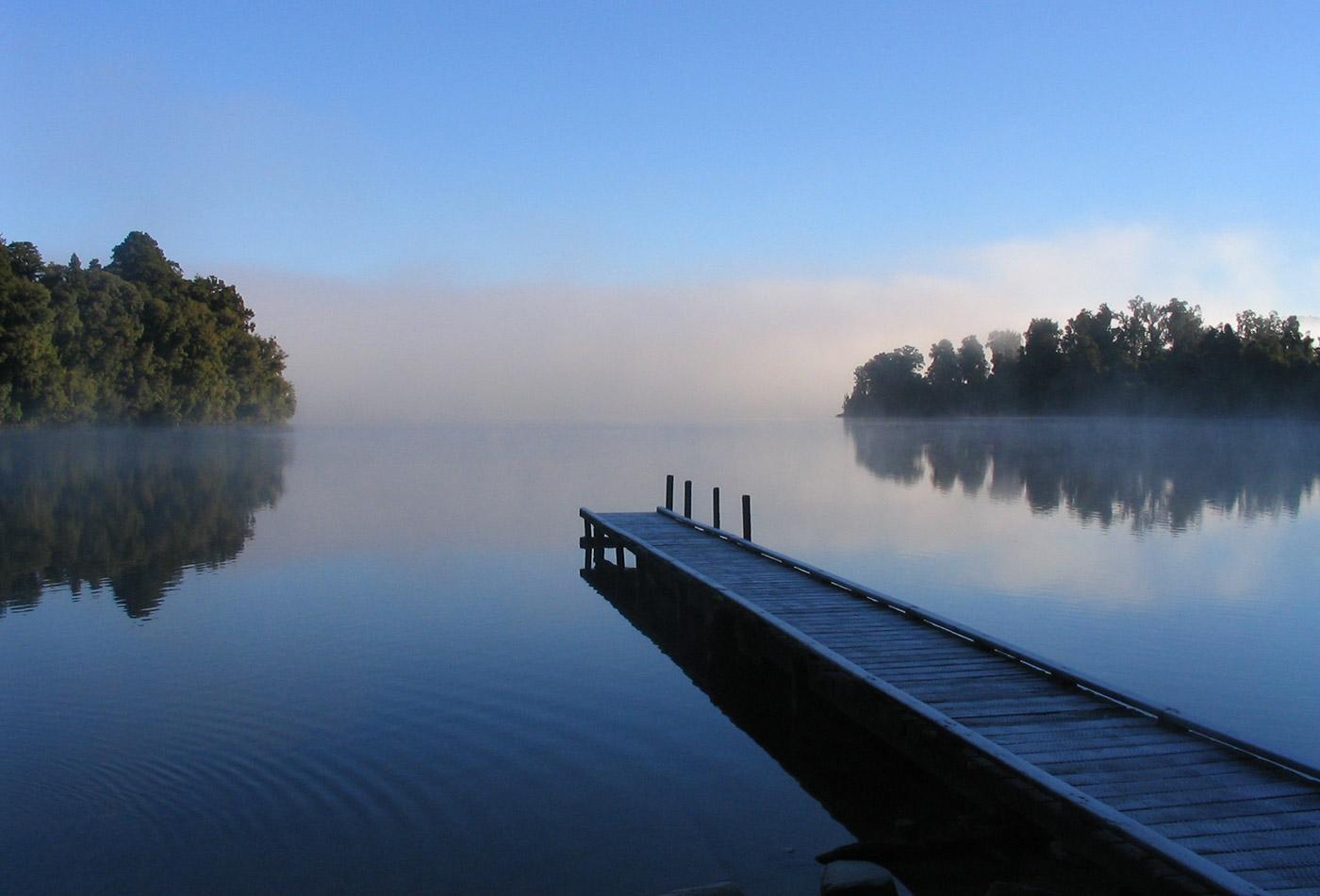 Morning mist on Lake Mapourika, New Zealand.