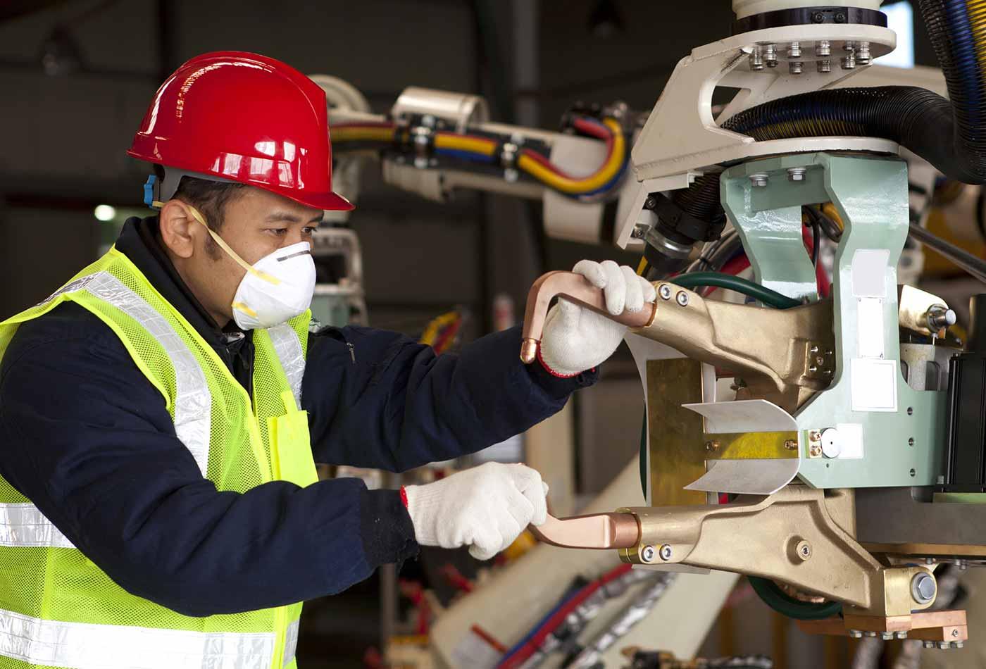 Worker examining machine