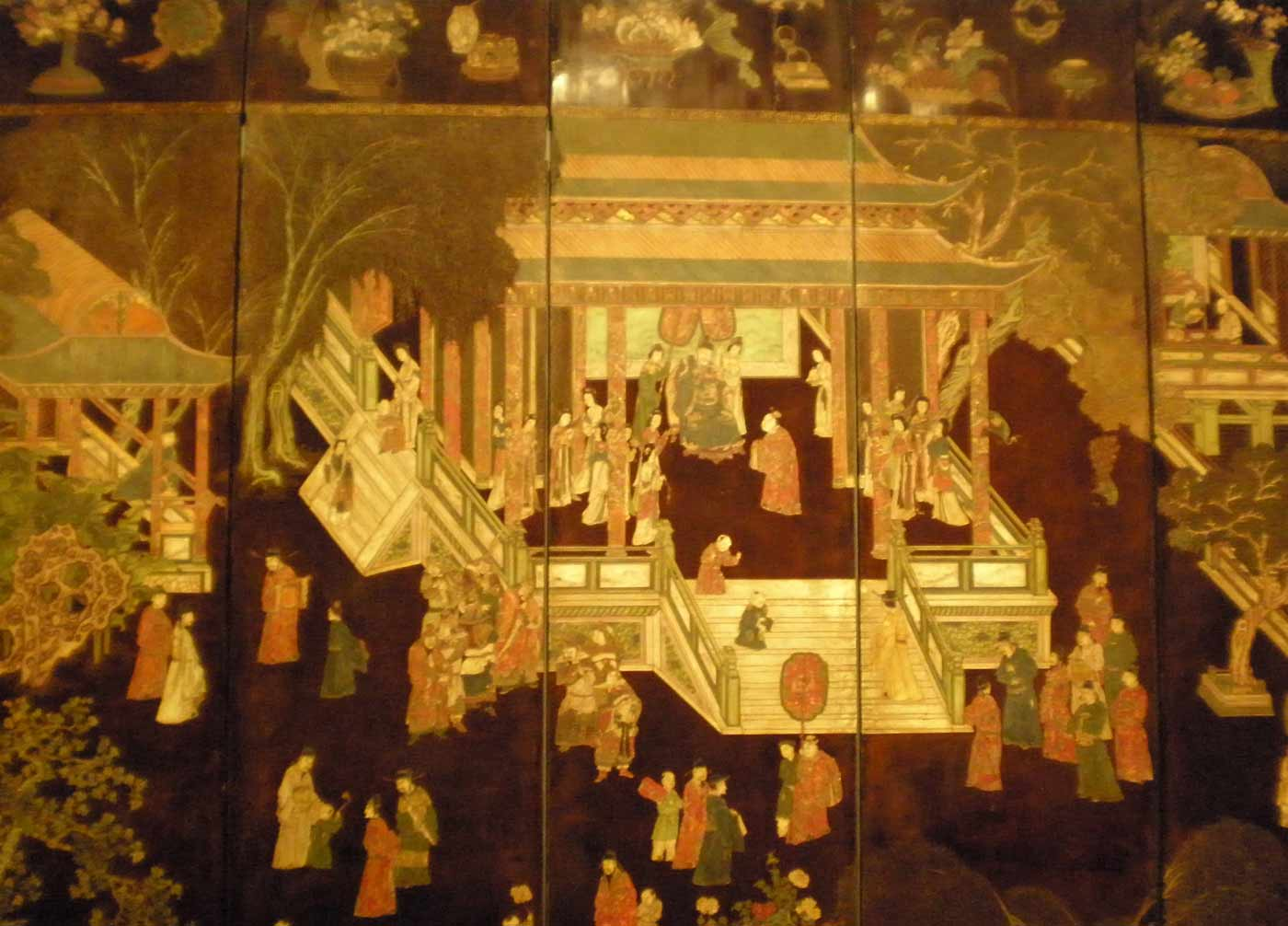 """A detail of """"Prosperity in an imperial palace"""", a 12-panel screen of lacquered wood (1670)."""