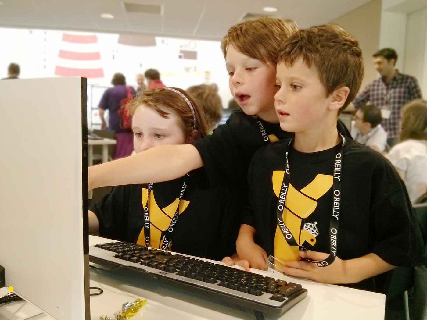Photo of three kids in front of a computer