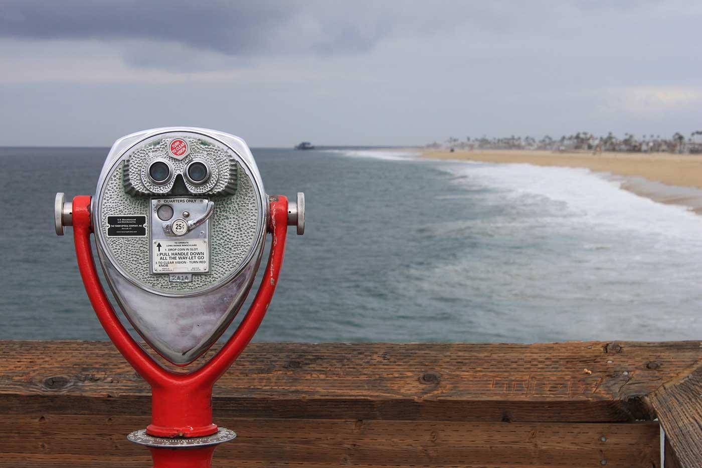 Binoculars looking over ocean