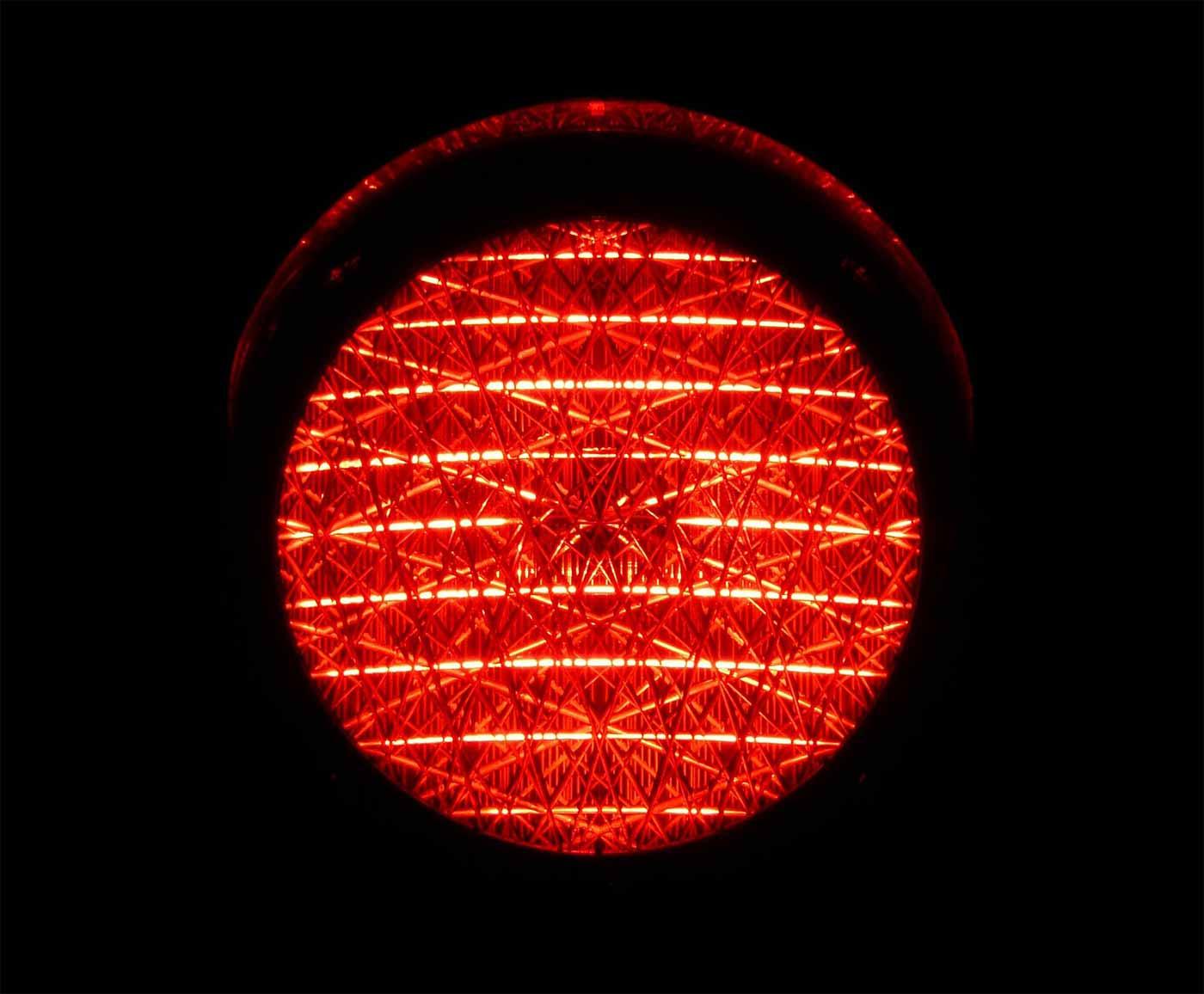 Red traffic light at night