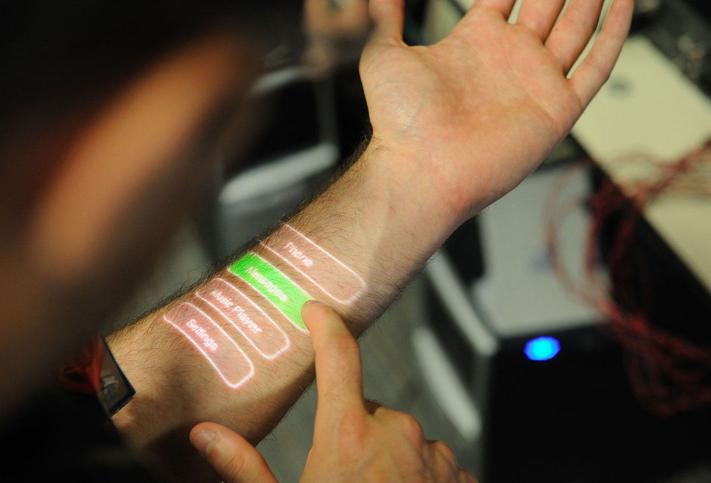 Skinput system using button-driven interface.