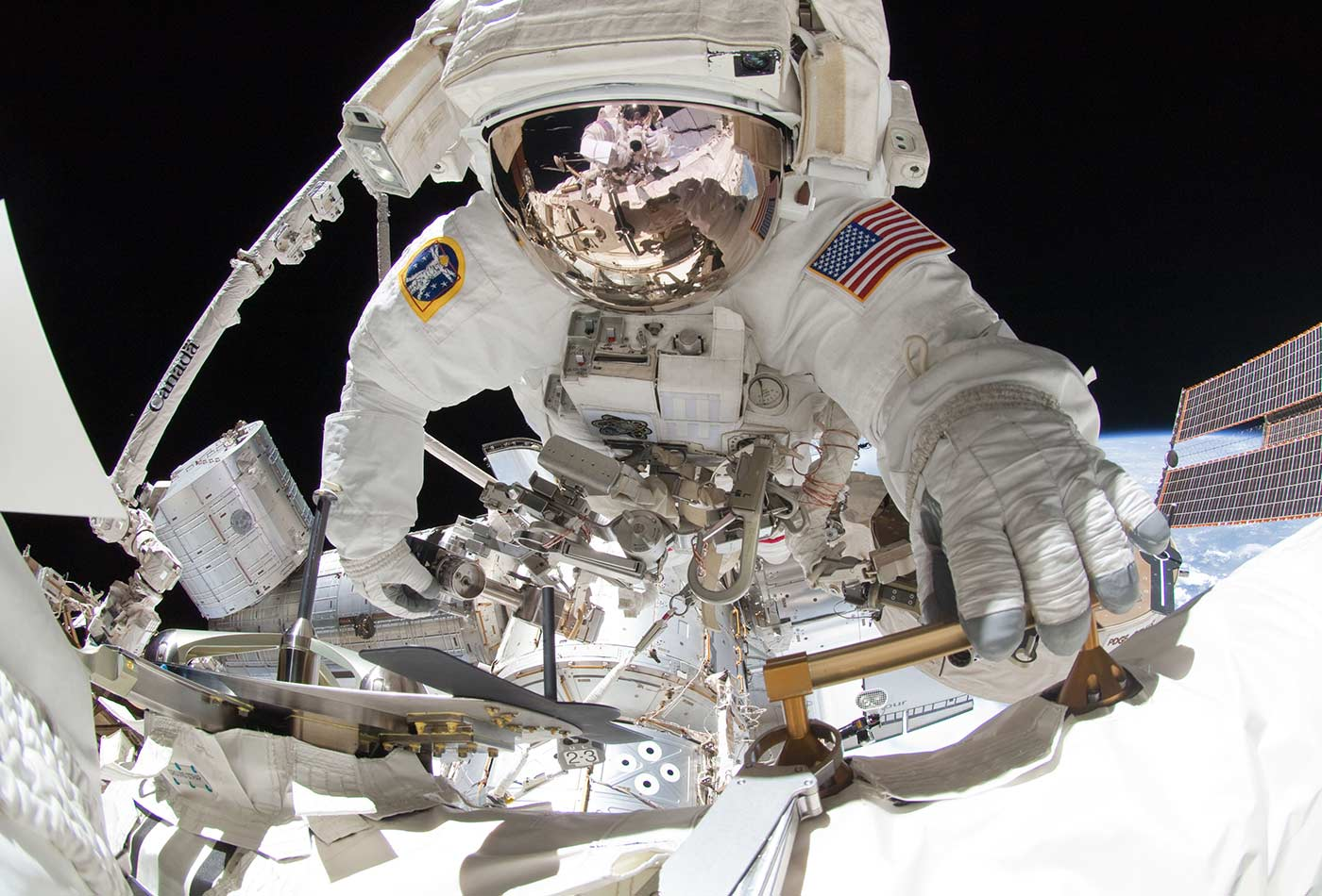 NASA astronaut Greg Chamitoff conducting extravehicular activity (EVA) on the International Space Station, 2011.