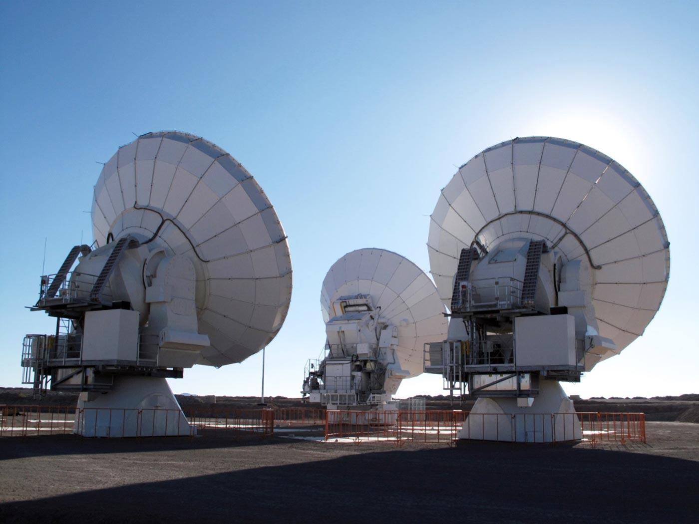Three ALMA antennas.