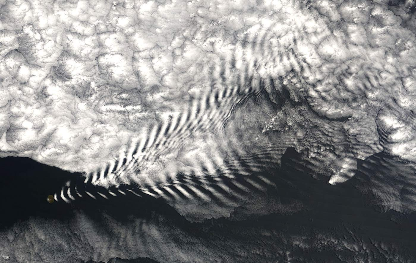NASA satellite image (MODIS imager on board the Terra satellite) of a wave cloud forming off of Amsterdam Island in the far southern Indian Ocean.