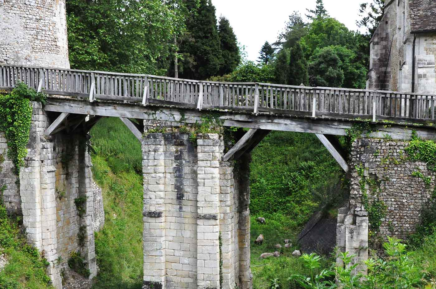 Stone and wooden bridge, castle of Harcourt (France, Normandy)