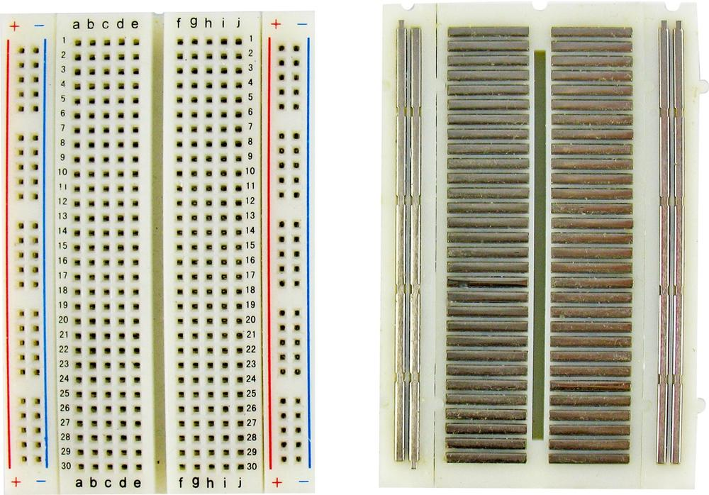 Breadboard front and back, showing metal clips