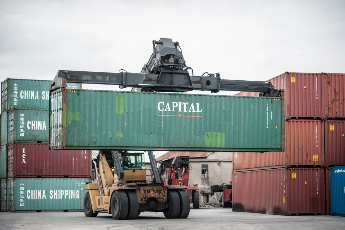 A crane lifting a shipping container