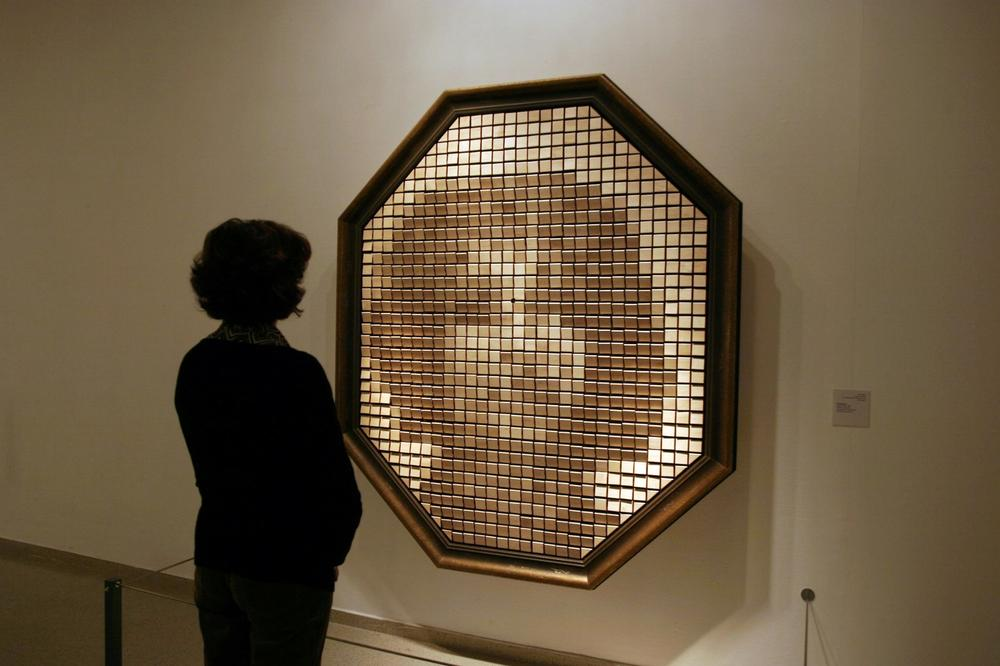 "The Wooden Mirror, which comprises a camera and dozens of individual slats of wood on motors, ""reflects"" the image of the person standing in front of it. Courtesy Danny Rozen."