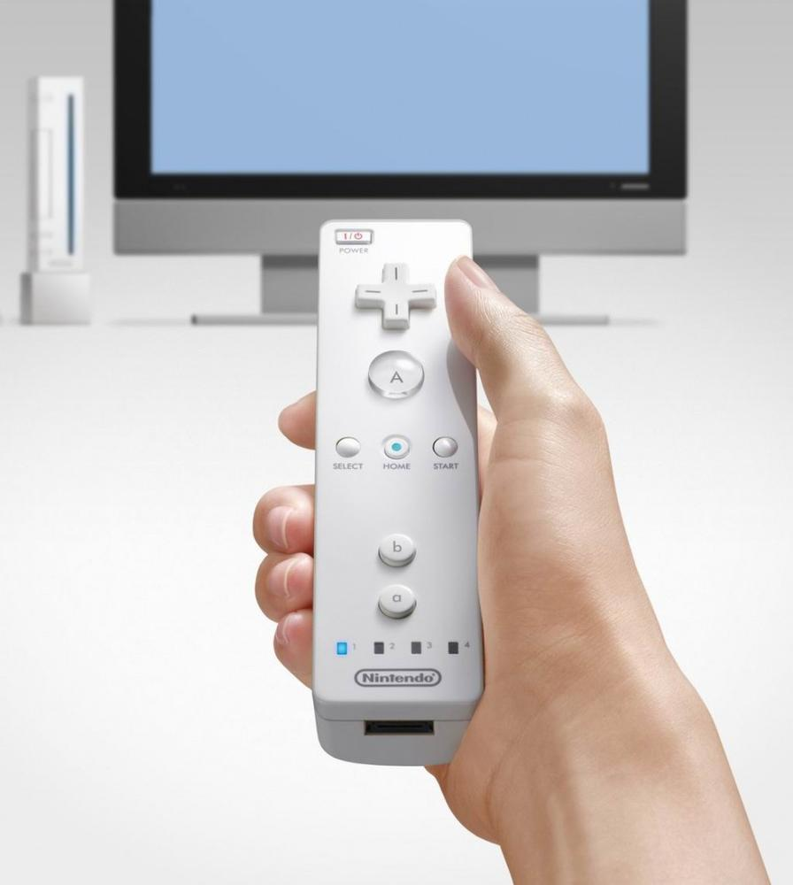 The Wiimote works with a stationary sensor bar on top of the TV screen, allowing users to use the device to Point to Select items on-screen. Courtesy Herman Yung.