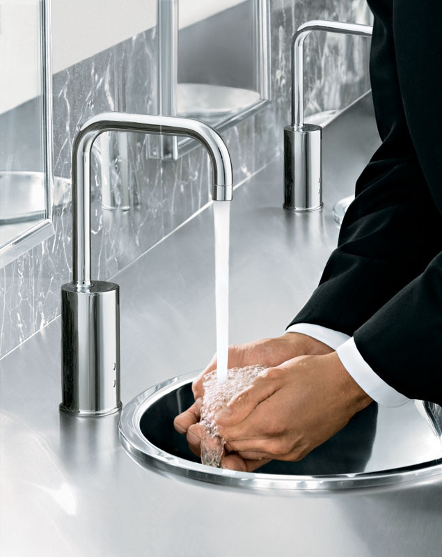 The Tripoint Gooseneck Touchless Electronic Faucet releases water when hands are placed inside the sink. Courtesy Kohler.