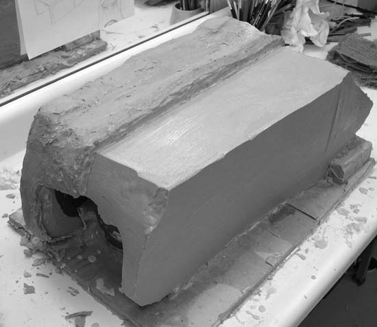 The silicone mold with one half of its plaster support shell