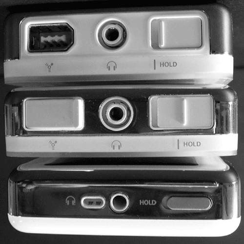 The headphone jack in the center and the Hold switch on the right side have remained up top in all generations of the iPod, but the FireWire port has roamed. The original 2001 iPod (top) is wider than later models and has no plastic cover for the FireWire port like the 2002 iPod (middle) does. The 2003 iPod (bottom) and the iPod Mini (not shown) has a remote jack closely aligned with the headphone port in the center. The Hold switch is still off to the right, but the FireWire port has changed shape and migrated to the bottom of the device.