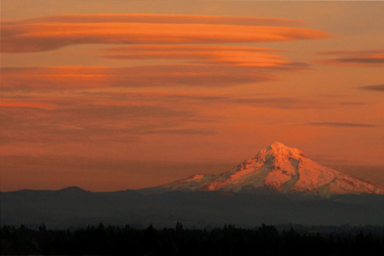 Lenticular clouds over Mount Hood in Oregon fill the sky after sunset. Exposure: ISO 640, f/8, 1/250 second, −1EV.