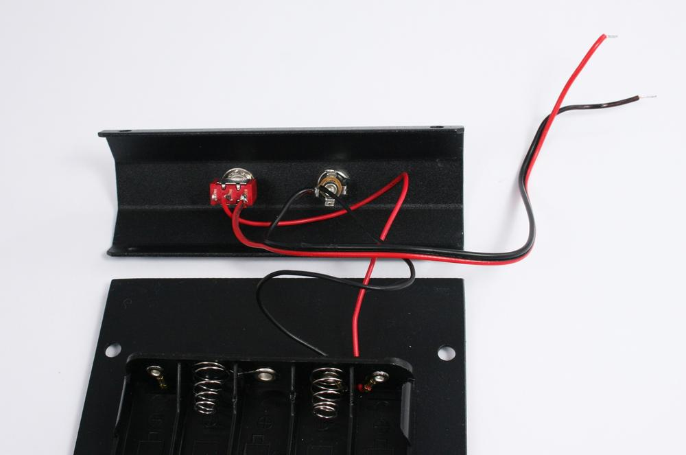 Red wires soldered to switch