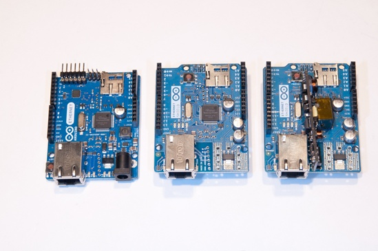 The Arduino Ethernet (left), an Arduino Ethernet shield (center), and an Ethernet shield with power-over-Ethernet module attached (right). You can use any of these for the Ethernet projects in this book.