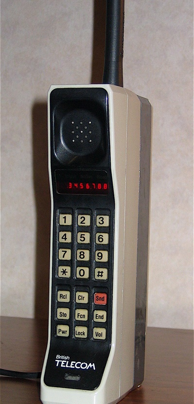 The Motorola DynaTAC 8000X was the first mobile phone to receive FCC acceptance, in 1983; DynaTAC was actually an abbreviation of Dynamic Adaptive Total Area Coverage
