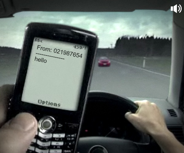 The distracted driver receives the text message