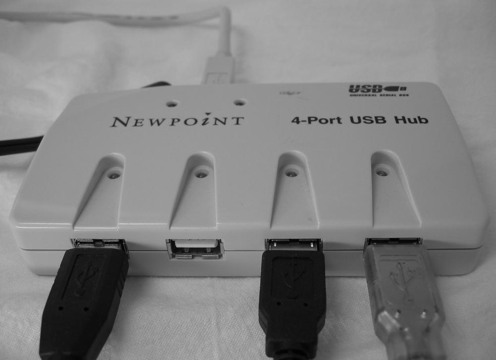 A powered USB hub not only turns one USB port into four USB ports, but supplies extra juice to USB devices that draw a lot of current—usually devices with bright lights, motors, hard drives, or other power-sapping features.