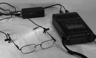 A set of binaural microphones on glasses, attached to a Marantz 660