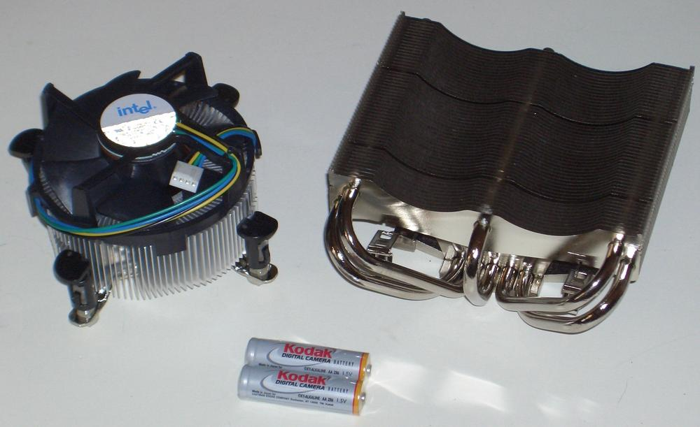 Intel stock CPU cooler (left) and Thermalright XP-120 CPU cooler, with AA batteries shown for scale