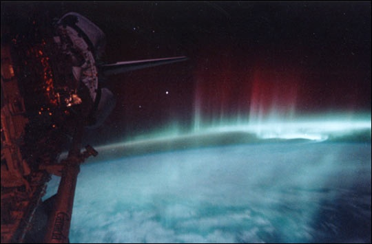 Space is beautiful, hostile, and survivable.  Image of an aurora from the space shuttle, courtesy of NASA.