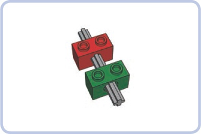 A regular axle put through two Technic bricks: The red brick has an X-shaped axle hole that locks the axles, while the green brick has a pin hole that allows the axle to rotate freely.