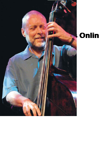 at right: Dave Holland, 2005. Nikon D2X, 1/250 sec, f/2.8, ISO 1600, 130 mm
