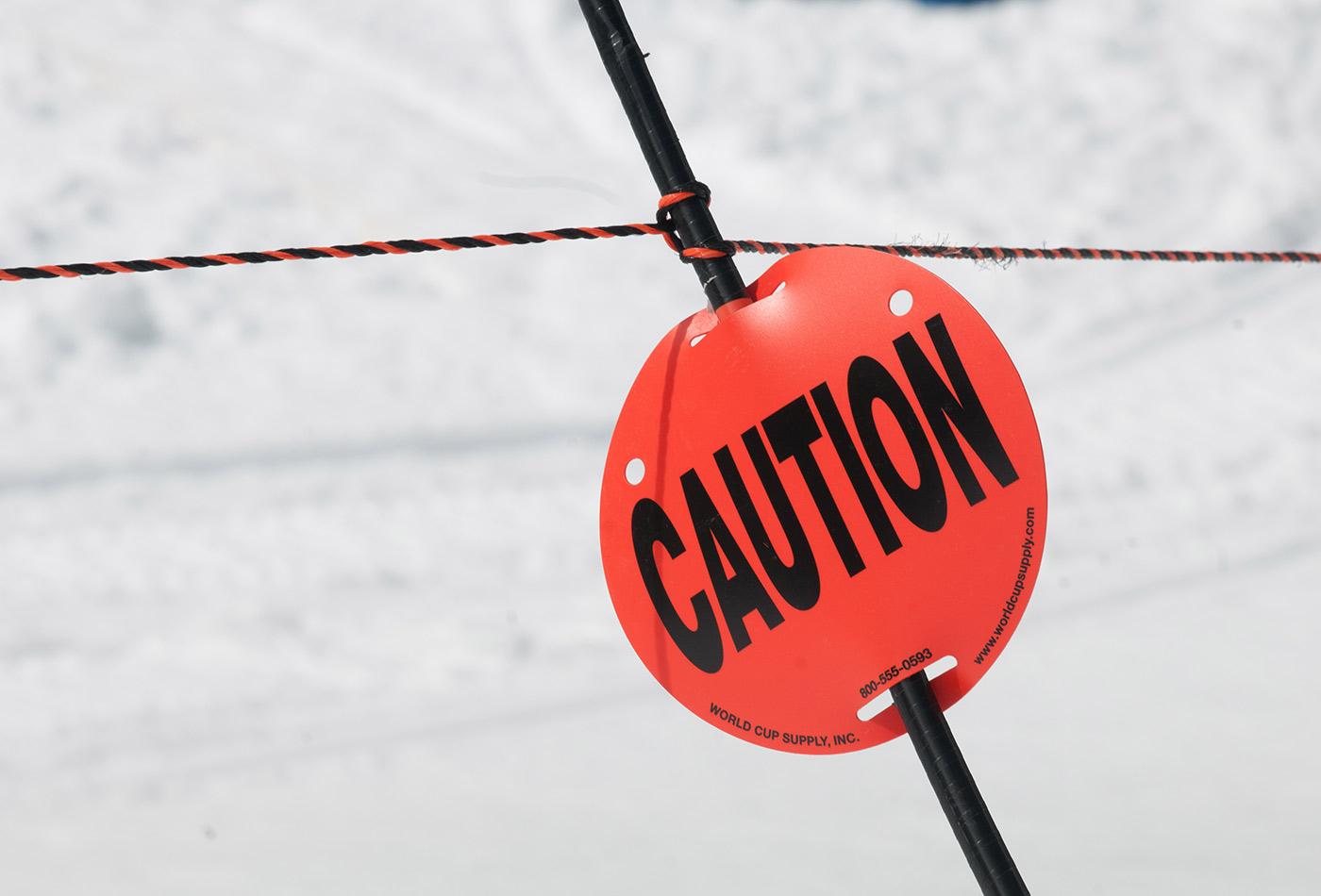 Caution sign on ski slope