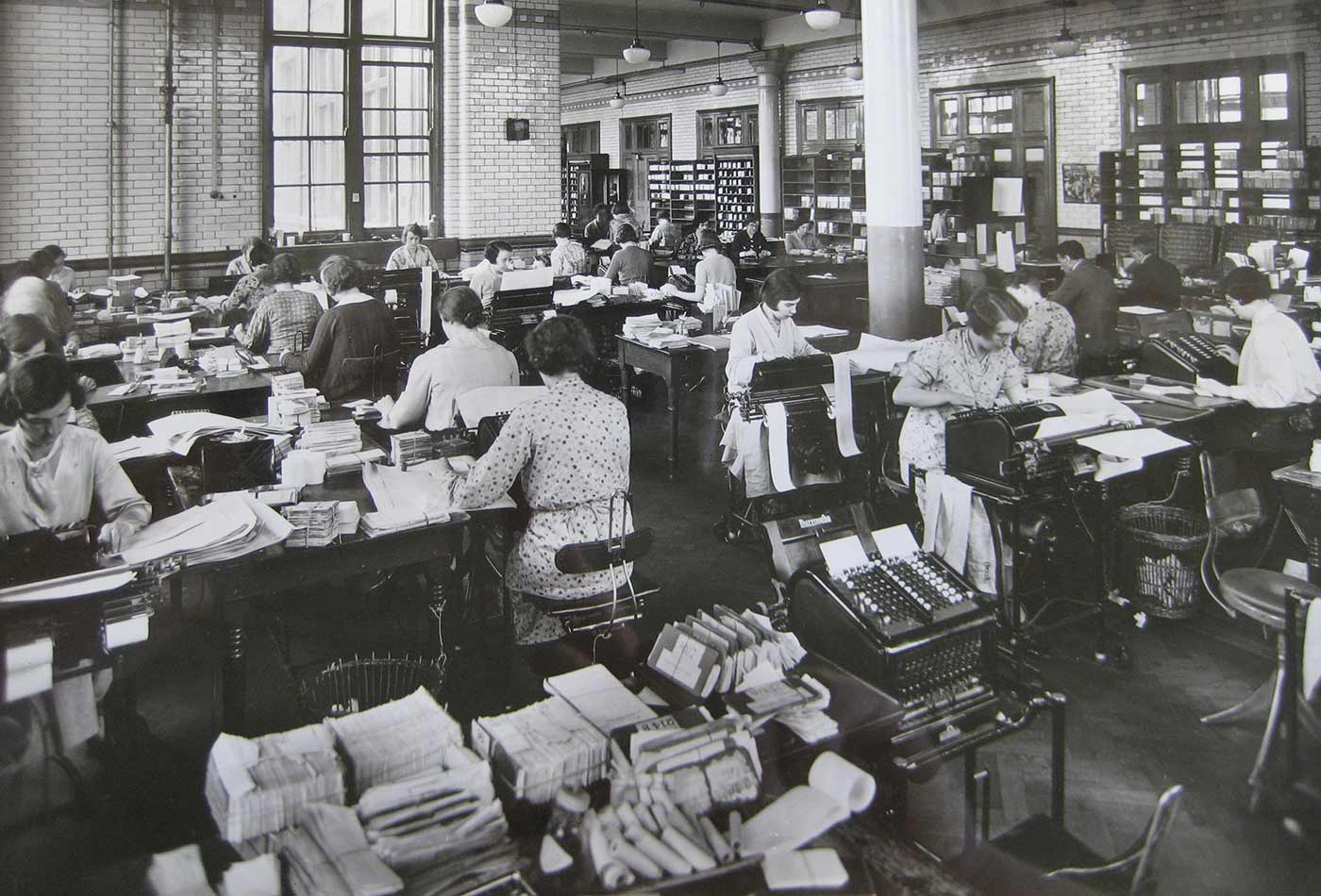 Blythe House preparing totals for daily balance, 1930s