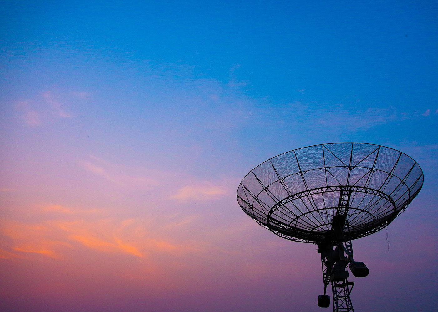 Radar dish at dusk