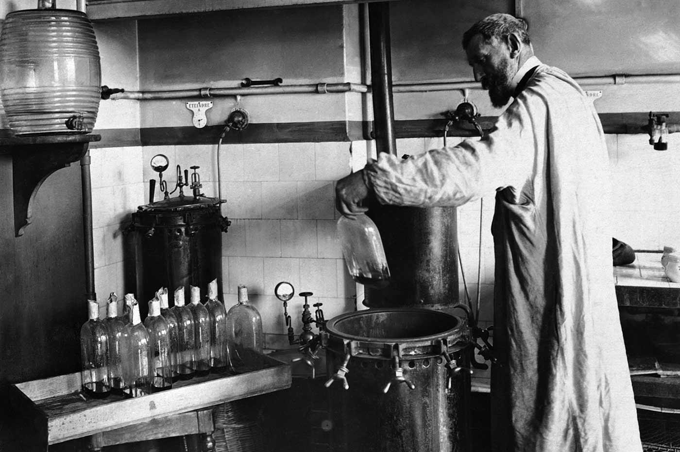 Louis Pasteur performing an experiment.